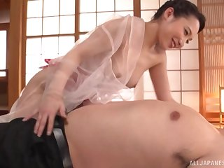 Japanese housewife Kichikawa Ren gives a sloppy clothed blowjob