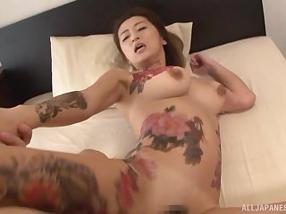 Two horny guys use and abuse a tattooed Japanese MILF