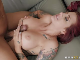 Inked bombshell redhead Tana Lea getting cum on face in the office