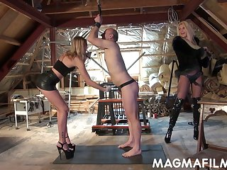 Domina Mandy Slim and her associate put on strapon and fuck submissive