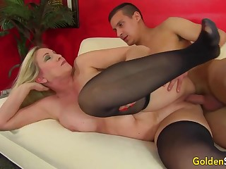 Towheaded mature bi-atch in dark-hued pantyhose, Cala Thirsts is penetrating a crumby boy like a superslut